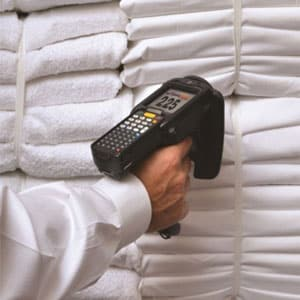 man scanning clean laundry/clothes with rfid handheld reader